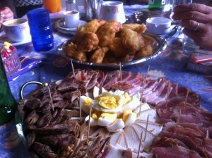 Pumpkin fritters, eggs, smoked pork, beef, sausages and cheeses.
